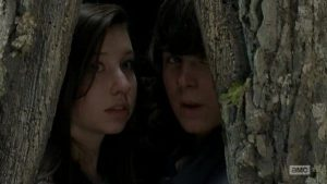 """Carl and Enid squeeze into a tree to take shelter from Walkers in the season 5 episode """"Try"""""""
